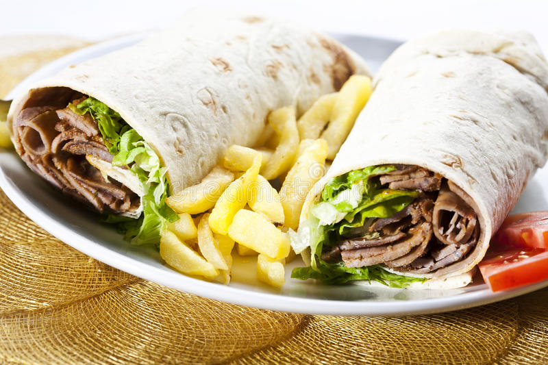 Kebab wrap. Turkish traditional food with french fries and vegetable