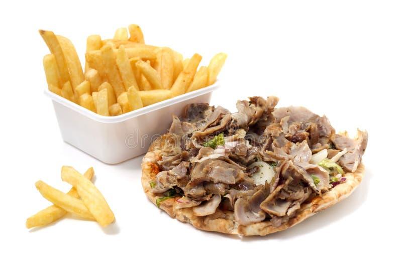 Kebabkött och småfiskar royaltyfria foton