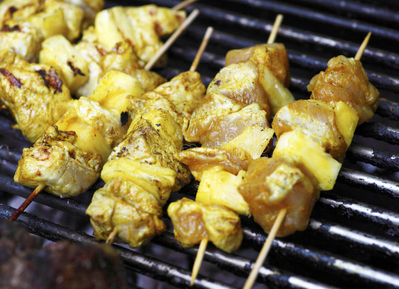 Kebabs on barbecue grill stock images