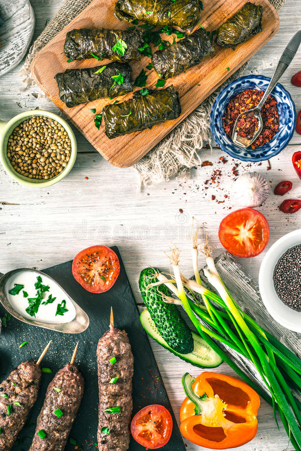 Kebabs with dolma, seasoning and vegetable. Concept Middle east , Asian and Caucasian cuisine vertical stock photo