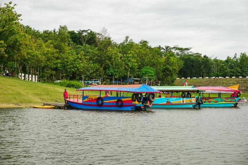 Kebumen, Central Java, Indonesia (12/30/2018) : Boat Tour in Sempor Dam. Sky, landscape, travel, beautiful, panorama, view, nature, water, beauty, mountain stock photo