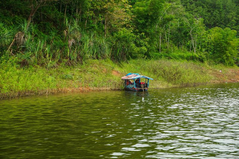 Kebumen, Central Java, Indonesia (12/30/2018) : The boat was pulled over the Sempor Dam. Sky, landscape, travel, beautiful, panorama, view, nature, water royalty free stock image
