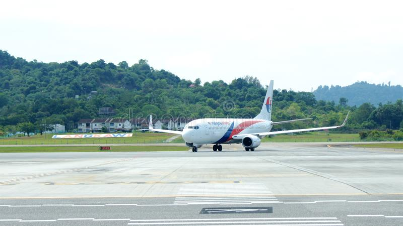 KEDAH, LANGKAWI, MALAYSIA - APR 11th, 2015: Malaysia Airline plane Boeing 737-800 at Langkawi international airport.  stock photos