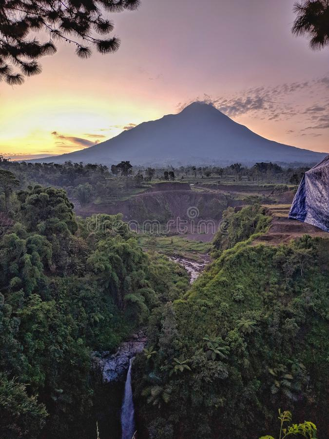Kedung kayang waterfall and Merapi mountain view. Sunrise with forest scenery. Magelang, Indonesia. Beautiful scenery stock photos