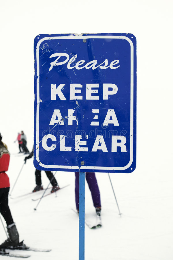 Keep area clear sign at ski slope. Sign at ski slope requesting area be kept clear stock photography