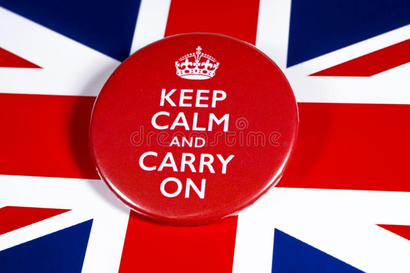 Keep Calm and Carry On. London, UK - November 22nd 2019: Keep Calm and Carry On symbol, pictured over the flag of the United Kingdom stock photo