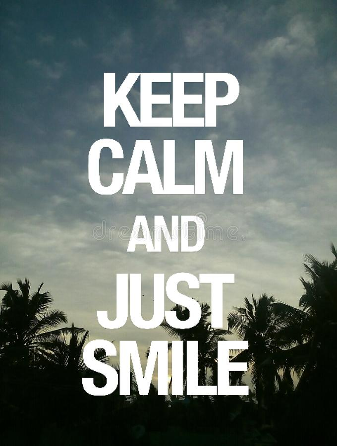 Keep calm and just smile stock photography