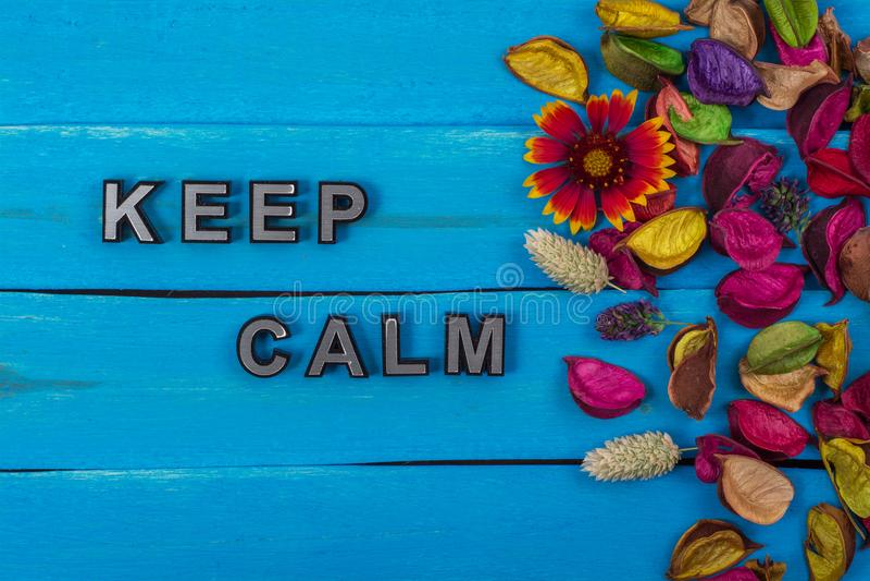 Keep calm text on blue wood with flower. Keep calm text on old blue color wood with flower and dried flower stock photos