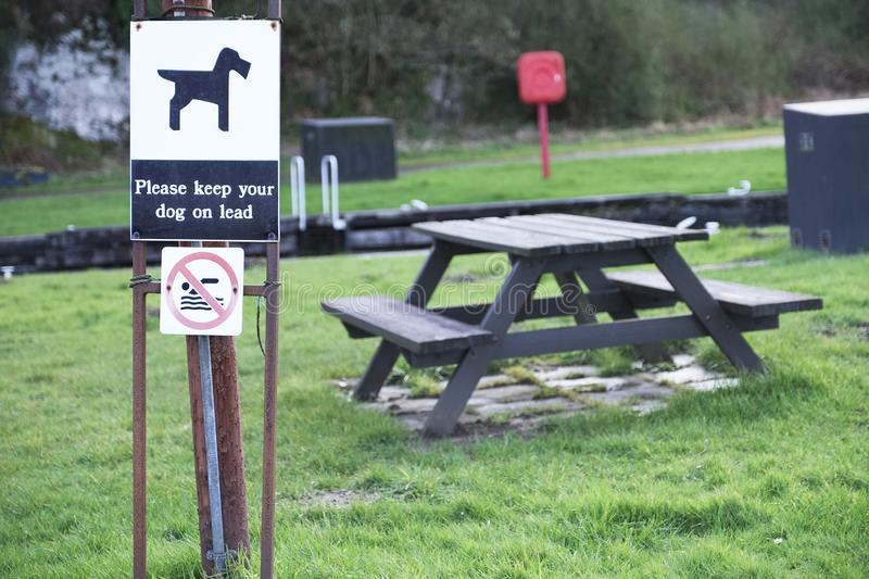 Keep dog on lead at family play picnic area sign. Uk royalty free stock images