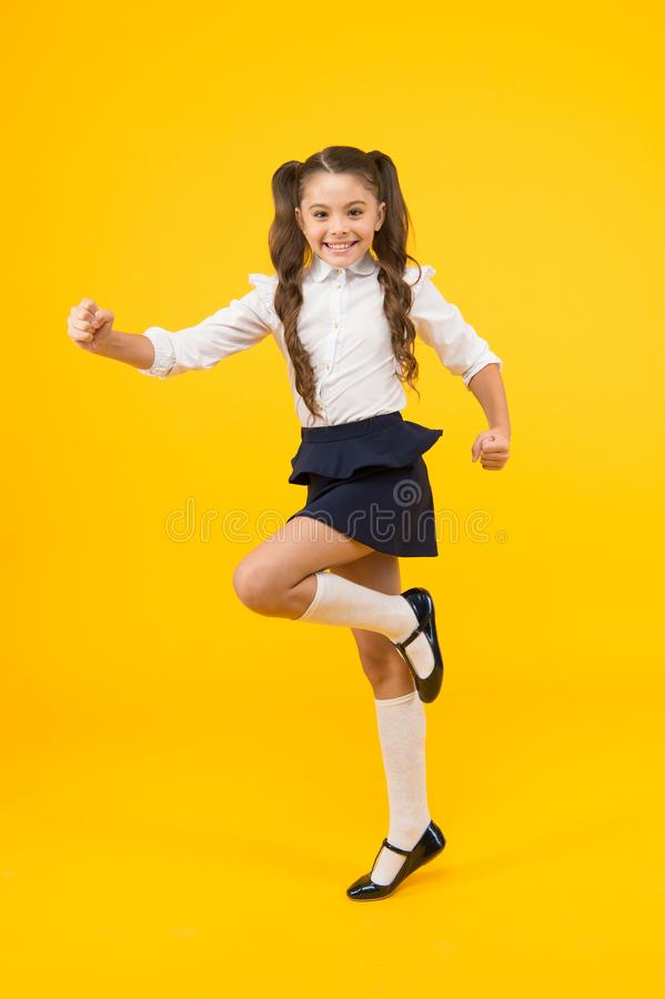Keep going. Active kid. Girl on way knowledge. Knowledge day. Back to school. Kid cheerful schoolgirl running. Pupil royalty free stock photos