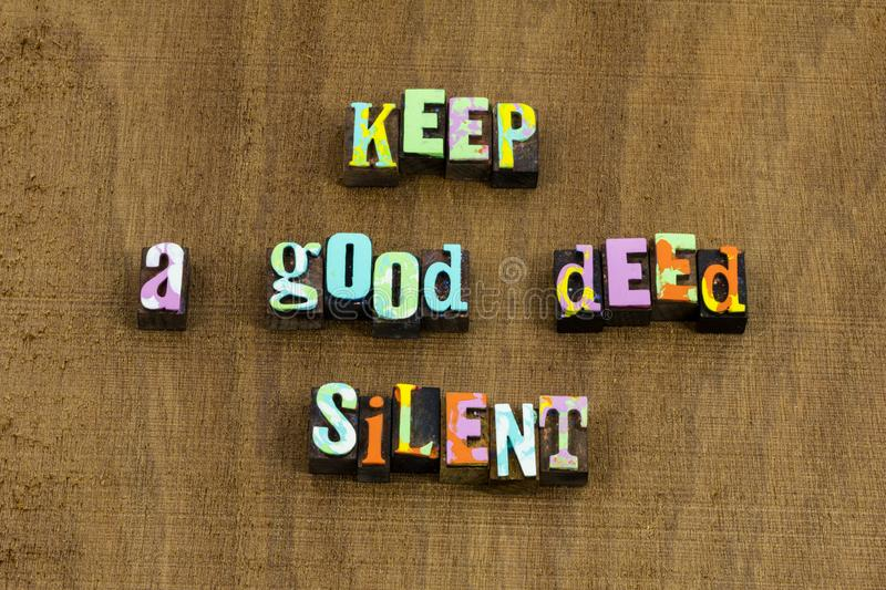 Keep good deed silent charity kind kindness quote. Letterpress typography karma help anonymous people helping hand others integrity volunteer goodness heart stock photo