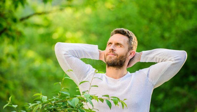 Keep it healthy way. Nature relax spa resort. Feel power of nature. Man handsome bearded guy morning stretching nature royalty free stock photo