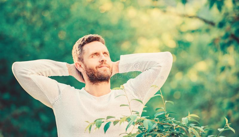 Keep it healthy way. Nature relax spa resort. Feel power of nature. Man handsome bearded guy morning stretching nature royalty free stock photography