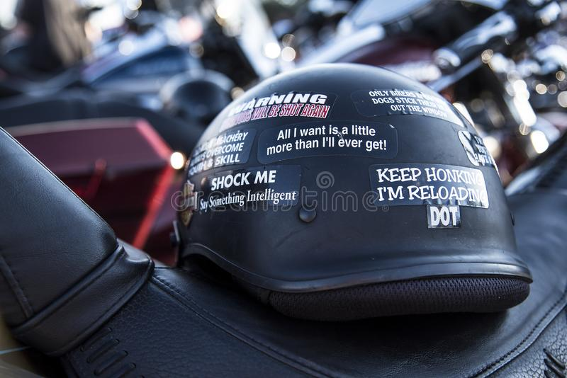 Keep honking I`m reloading sticker on black motorcycle helmet. Funny sayings royalty free stock photography