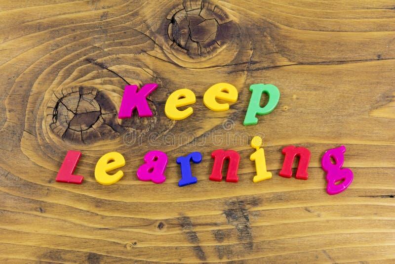 Keep learning learn teach school child typography. Keep learning learn teach school child typeography letterpress children teaching school preschool plastic stock photos