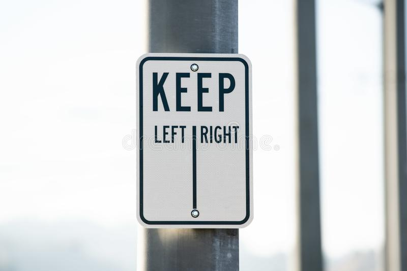 Keep left right sign on the metal pole royalty free stock photography
