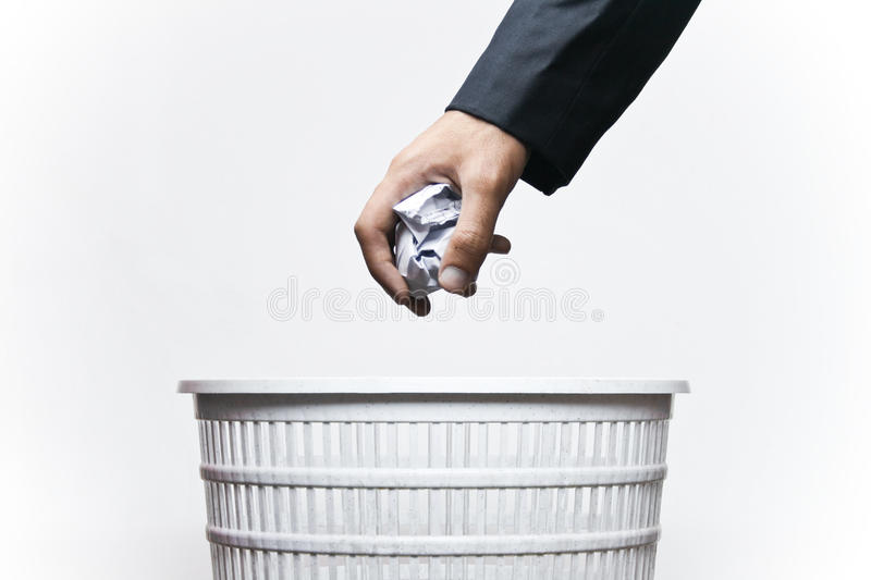 Keep your city clean!. A man throwing waste in a bin stock images