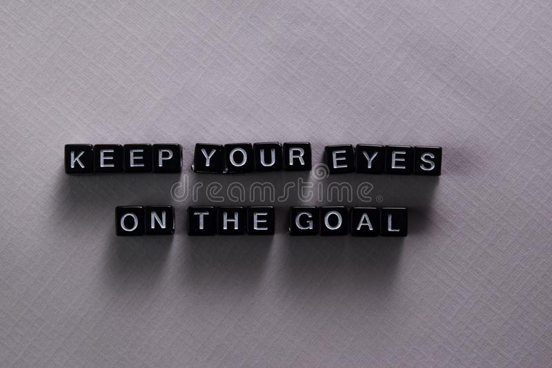 Keep your eyes on the goal on wooden blocks. Motivation and inspiration concept stock image