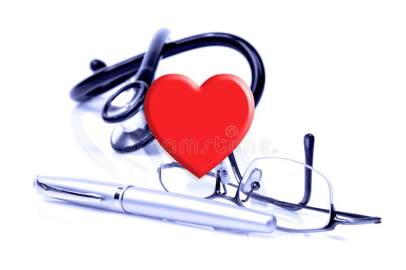 Heart, glasses, a pen and stethoscope on the white background. Keep your heart consept stock photos