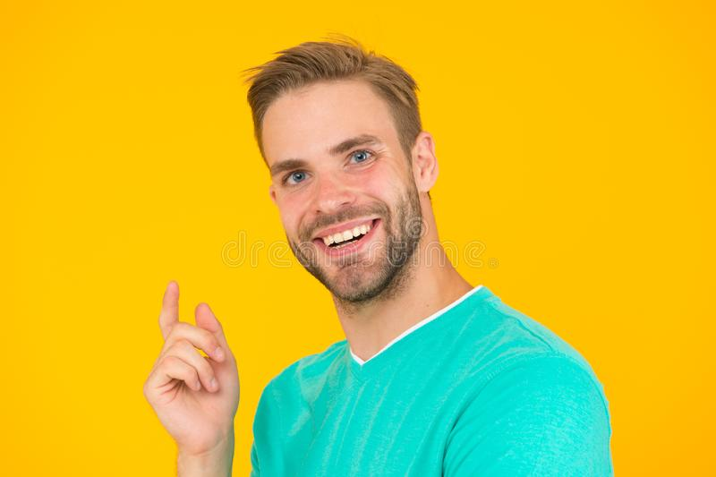 Keep youth. Kind smile. Self care. Handsome man yellow background. Well groomed guy with bristle and nice hairstyle stock image