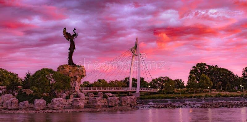 Keeper of the Plains Indian. Morning sunrise on the Arkansas River with the Keeper of the Plains staue stock photo