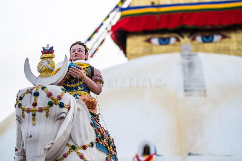 Keepers of the stairs at Boudhanath stupa, Nepal. Keepers of the stairs statue in front of Boudhanath stupa, Nepal royalty free stock photography