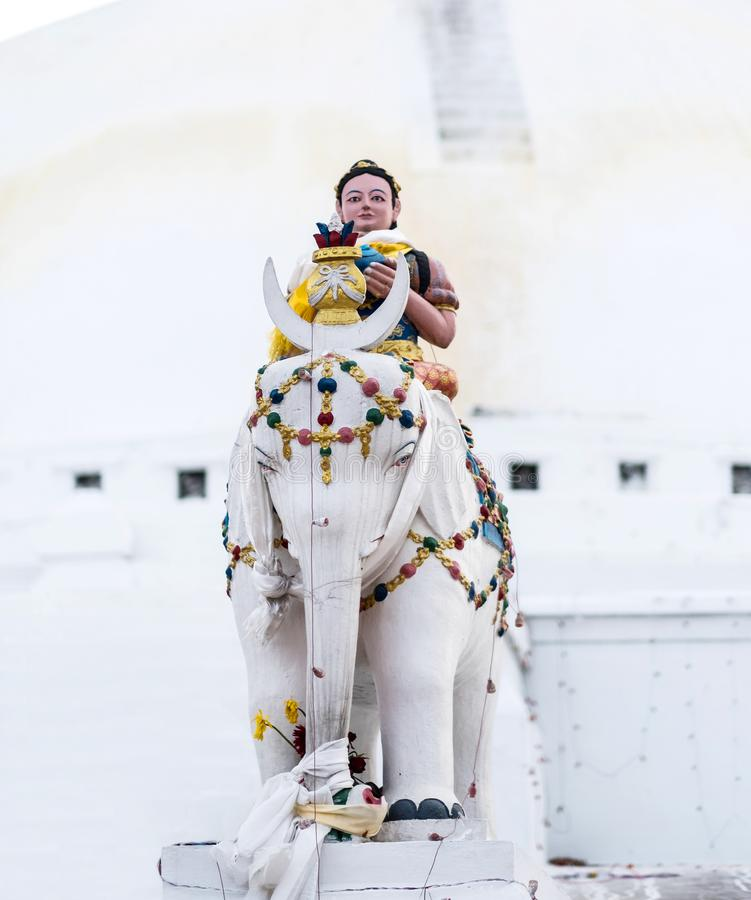 Keepers of the stairs at Boudhanath stupa, Nepal. Keepers of the stairs statue in front of Boudhanath stupa, Nepal royalty free stock photos