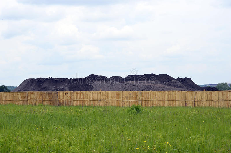 Keeping the soil in the open ground in the warehouse site with a fence.  stock photo