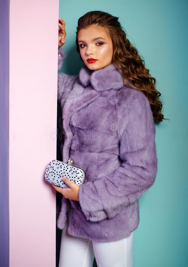 Keeping things cosy as well as cute. Young woman wear elegant winter coat. Pretty woman in fashionable fur coat. Winter. Fashion trends. Fashion model wear stock images
