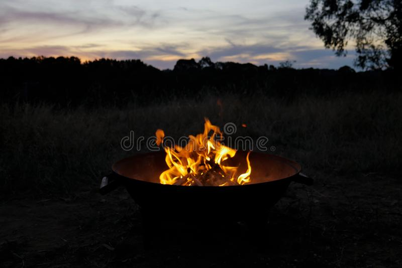 Warming beside the fire pit royalty free stock photos