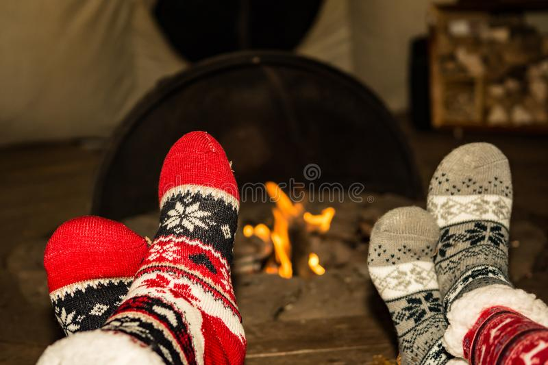 Keeping feet warm by the fire royalty free stock images