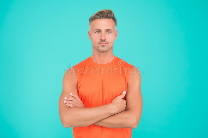 Keeping your fitness goals during social distancing. Exercising is crucial to combat stress and boost your immune system. Man mature sportsman. Exercising at stock image