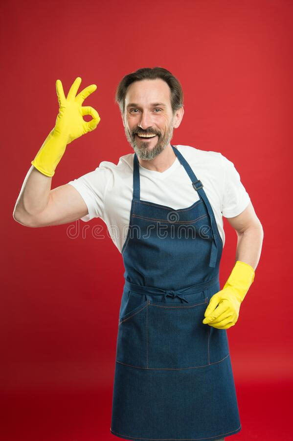 Keeping your home clean. Happy cleaner in yellow gloves show ok sign. Household work. Housekeeping routine. Cleaning. Service. Sanitation. Clean up. House clean royalty free stock photo
