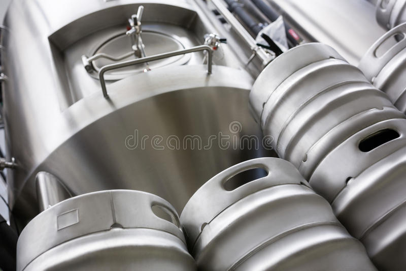 Keg and beer distillery at bewery. Low angle view of keg and beer distillery at bewery stock image