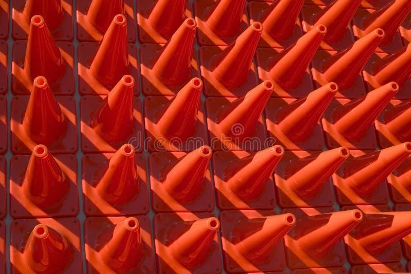 Kegel in einem Muster stockfotos