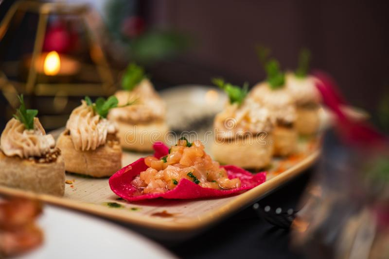 Kegs with salmon fish and cream sauce. Tasty restaurant dish royalty free stock image