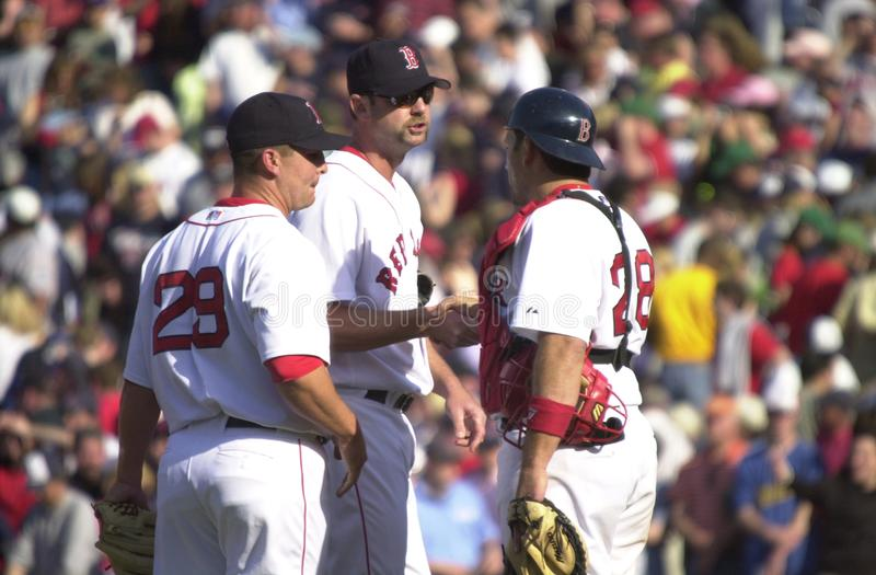 Keith Foulke, David McCarty and Doug Mirabelli. Boston Red Sox teammates Keith Foulke, David McCarty and Doug Mirabelli meet on the mound. Image taken from color royalty free stock photo