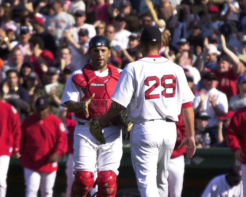 Keith Foulke and Doug Mirabelli. Boston Red Sox closer Keith Foulke and catcher Doug Mirabelli shake hands after a Red Sox victory at Fenway Park. Image taken royalty free stock images