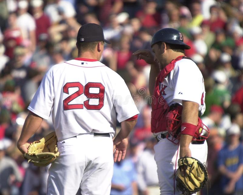 Keith Foulke and Doug Mirabelli. Boston Red Sox closer Keith Foulke and Doug Mirabelli discuss signals on the mound. Image taken from color slide royalty free stock photo