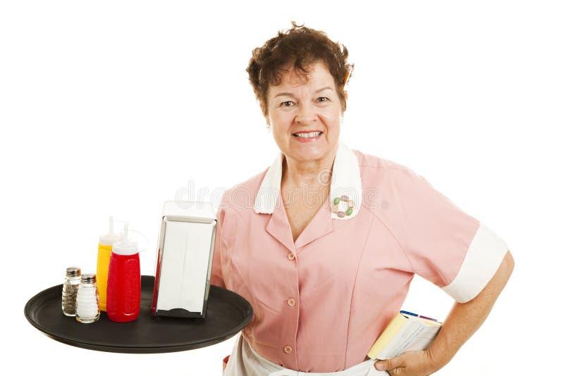 Kellnerin, die aufräumt lizenzfreies stockbild
