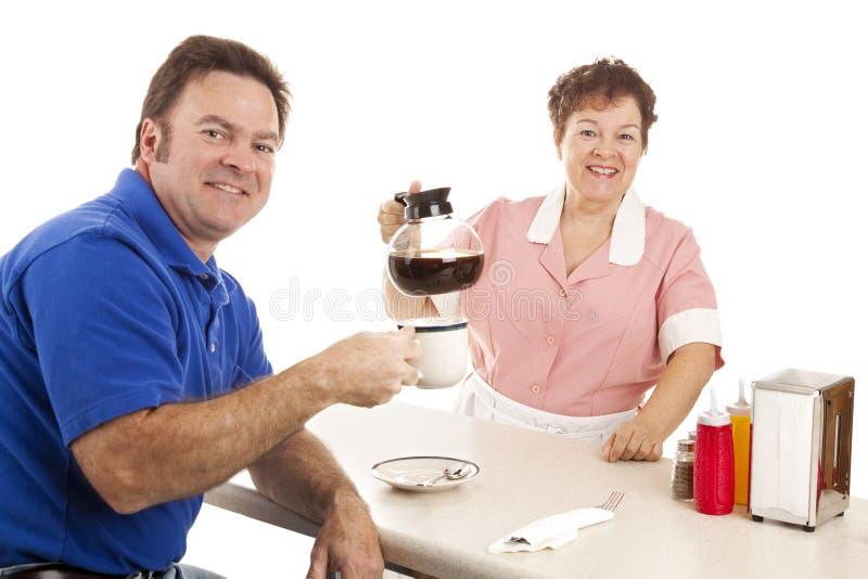 Kellnerin und Abnehmer im Restaurant lizenzfreies stockbild