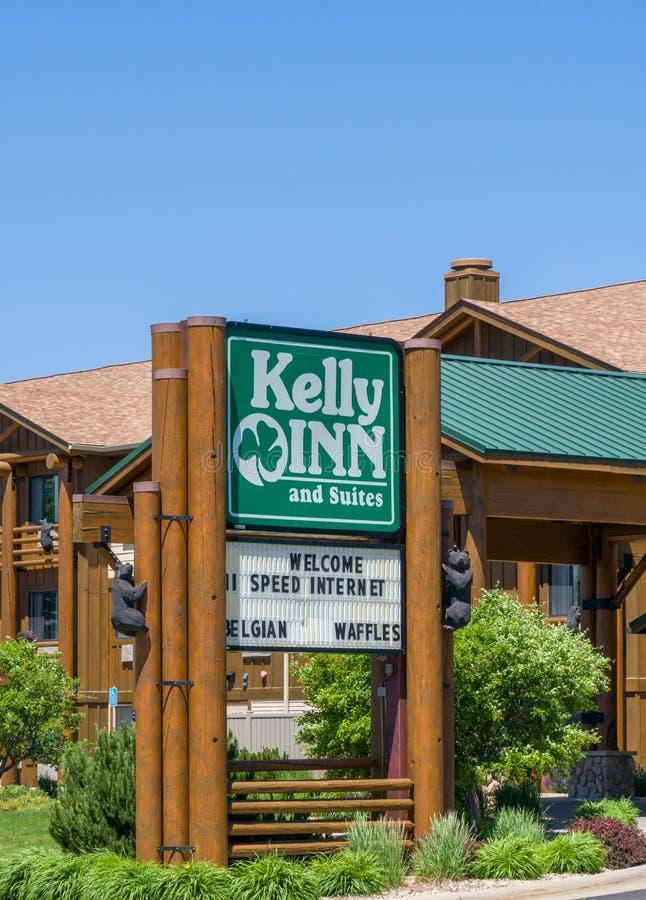 Kelly Inn y exterior y logotipo de las habitaciones fotografía de archivo