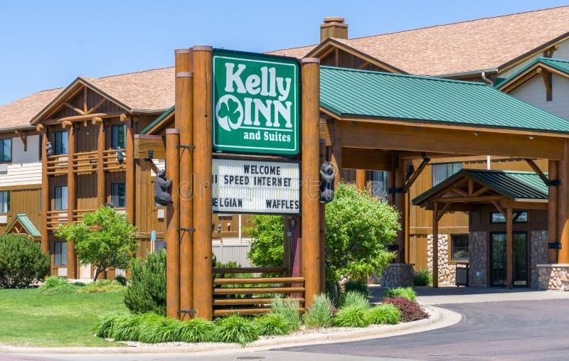 Kelly Inn y exterior y logotipo de las habitaciones imagen de archivo libre de regalías