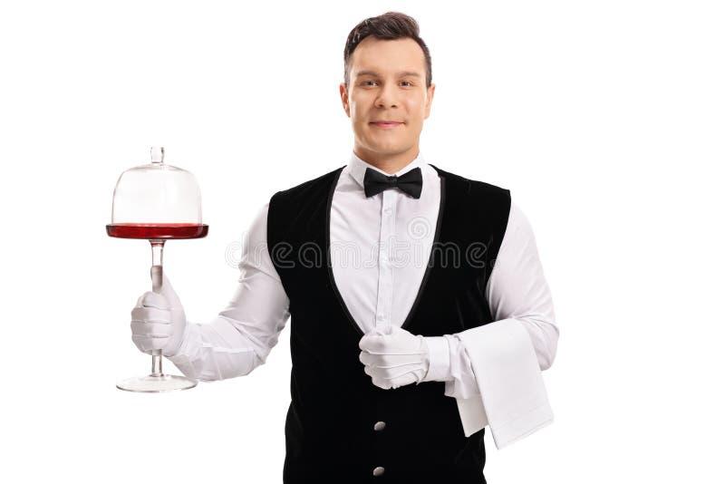 Kelner die een tribune van de cakeserver houden royalty-vrije stock fotografie