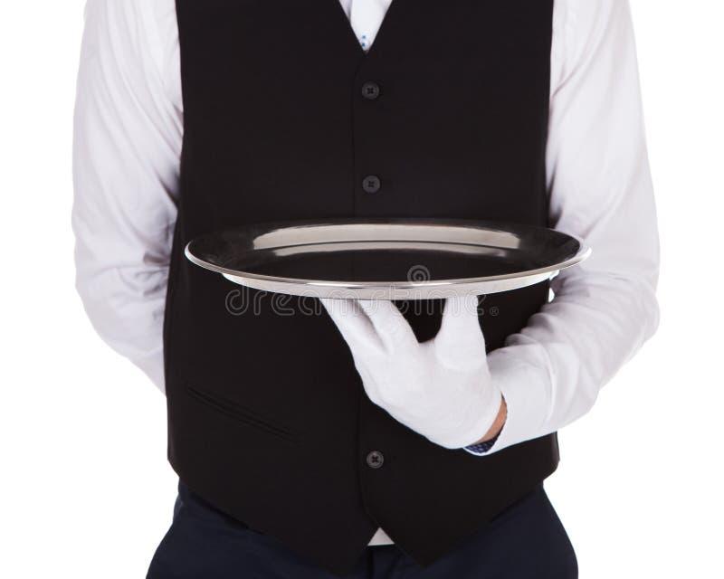 Kelner die leeg dienblad houden stock foto's