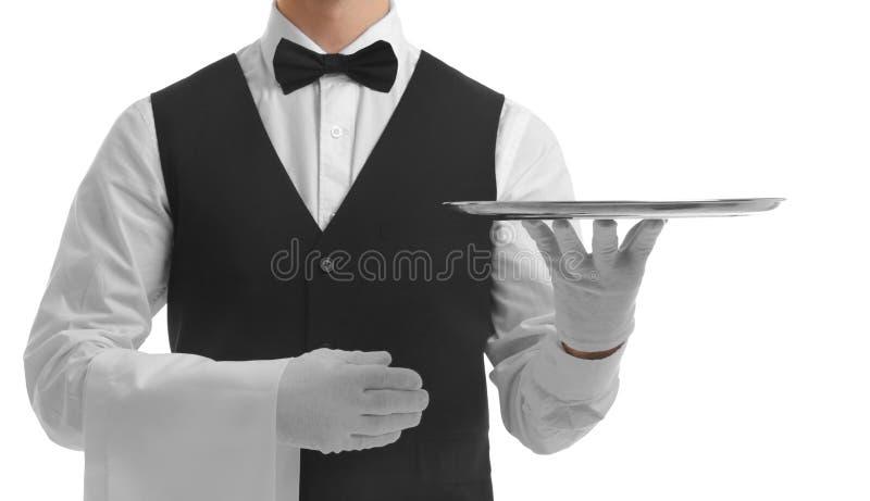 Kelner die leeg zilveren dienblad houdt stock foto's