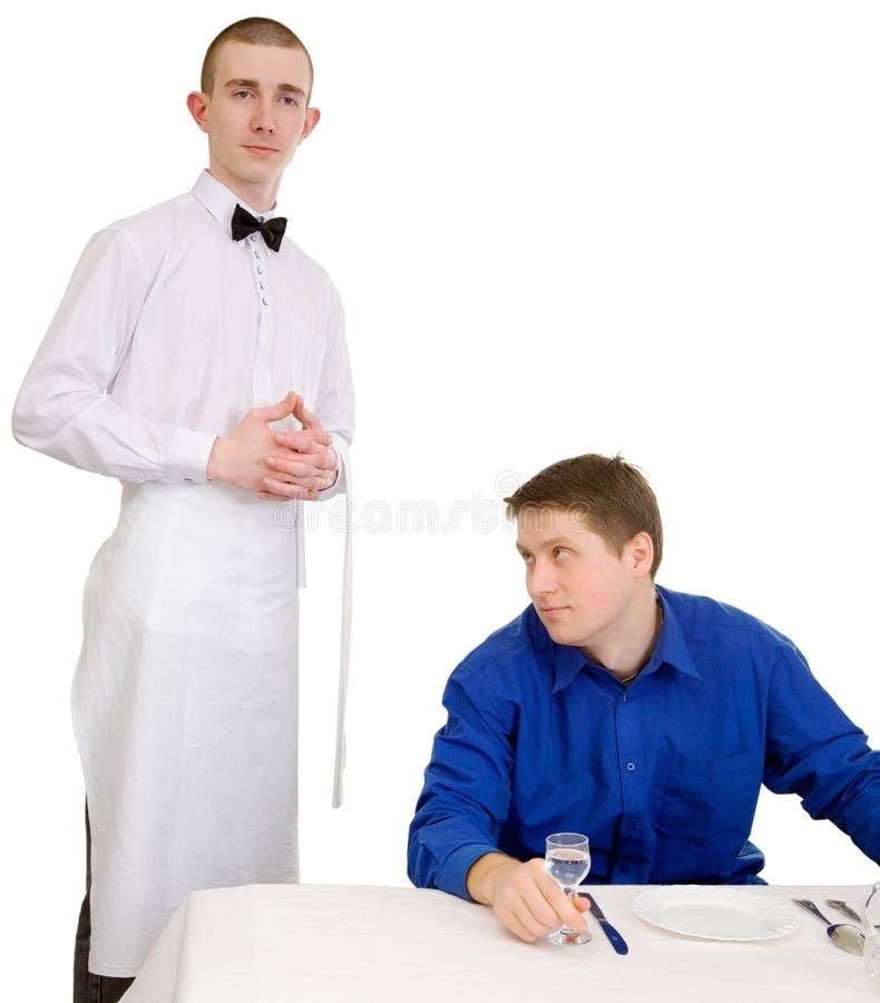 Kelner en gast van restaurant stock afbeelding