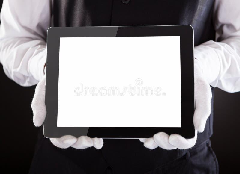 Kelner Holding Digital Tablet royalty-vrije stock foto