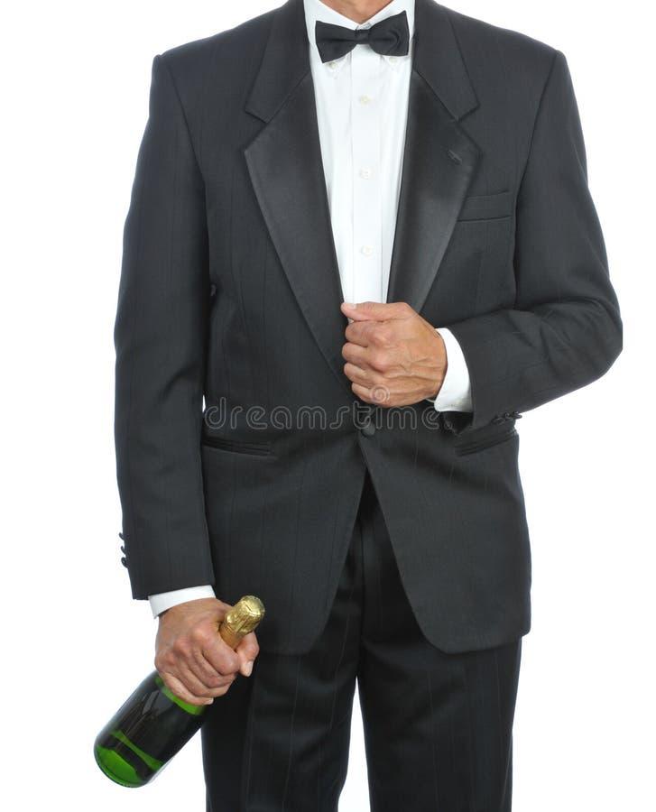 Kelner met de fles van Champagne stock afbeeldingen
