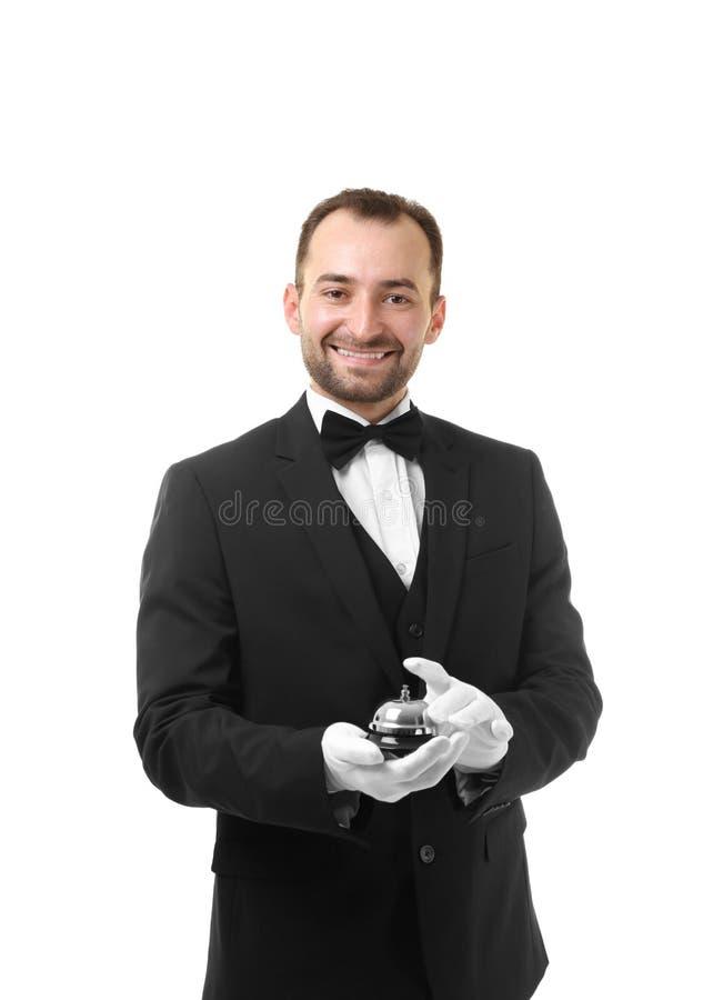 Kelner met klok op achtergrond stock foto's